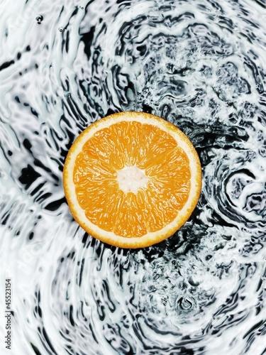 Half an orange on water