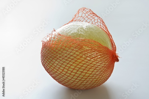 Pomelo in torn net