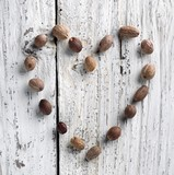Nutmeg Heart on Rustic White Washed Wood