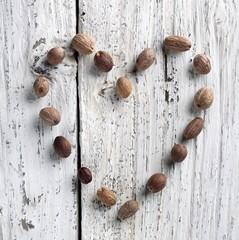 Nutmeg Heart on Rustic White Washed Wood