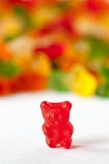 Red Gummie Bear; Many Gummie Bears in Background
