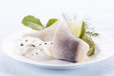 Soused herring fillets with limes and sour cream
