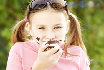 A girl eating a chocolate marshmallow