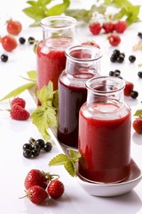 A raspberry smoothie, a redcurrant smoothie and a strawberry smoothie