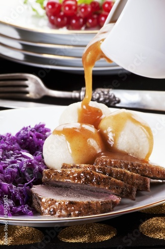 Roast goose with dumplings, red cabbage and gravy