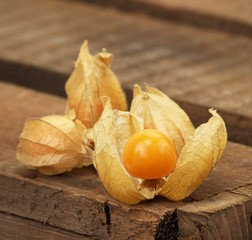 Physalis on a wooden bread