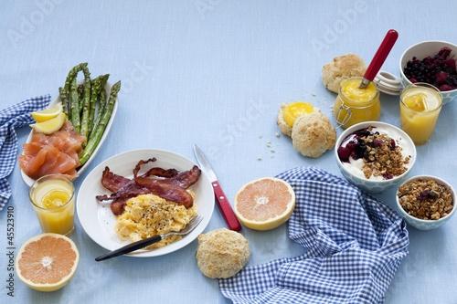 a breakfast table laid with scrambled egg salmon jam muesli and grapefruit de foodlovers. Black Bedroom Furniture Sets. Home Design Ideas