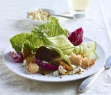 Salad with Croutons Dressed with Oil and Vinegar on a White Plate