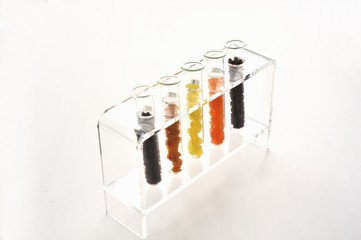 Various dried fruits in test tubes