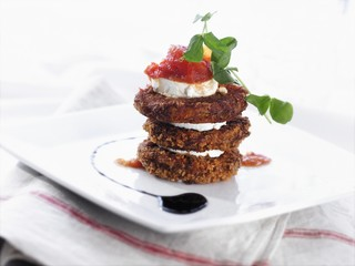 Stacked Fried Green Tomatoes Layered with Goat Cheese Topped with Strawberry Orange Jam