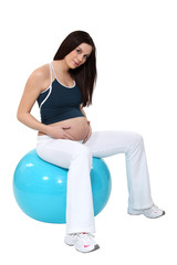 Pregnant woman bouncing on a birth ball