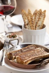 Roasted Marrow Bones; Grilled Bread Slices and a Glass of Wine