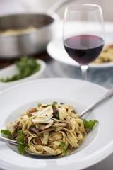 Fettuccini Pasta with Pancetta, Peas, Artichoke Hearts, Wild Mushrooms and Parsley