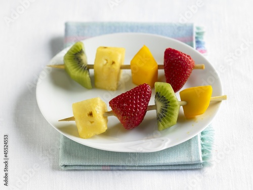 Two Fruit Kabobs on a White Plate