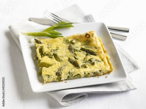 Slice of Asparagus Frittata on a White Plate