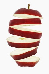 Flying slices of red apple