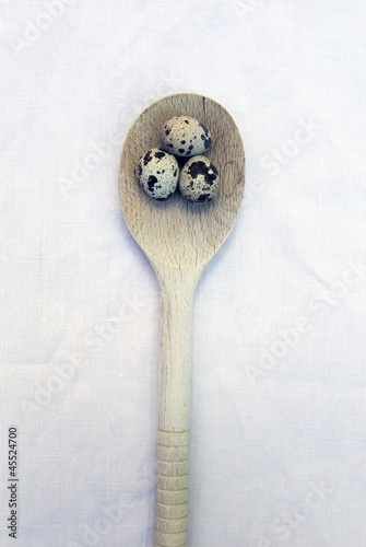 Three Quail Eggs on a Wooden Spoon