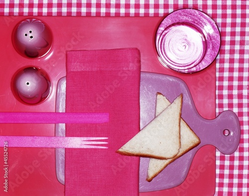 A pink place setting with toast triangles