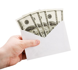 hand holding an envelope with money