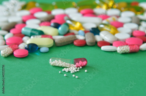 Drug on green background