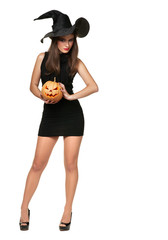 pretty young brunette woman with a pumpkin