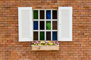 Vintage white window on red brick wall