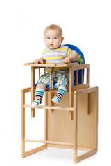 Baby sitting in highchair.