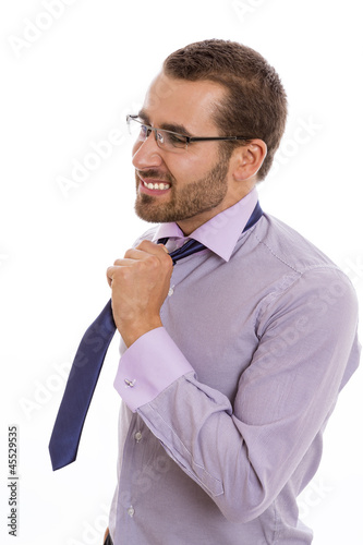 Portrait of anxious businessman loosening his necktie.
