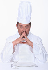 Chef sitting at a table