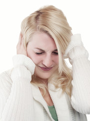 Young blonde woman has terrible pain - closeup- - isolated