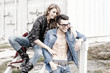 stylish couple wearing jeans and boots smiling