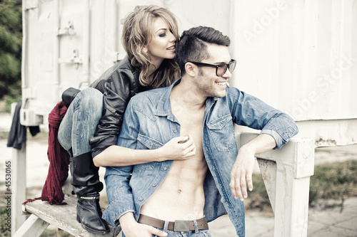 stylish couple wearing jeans and boots smiling - 45530165