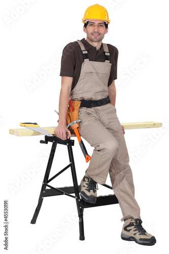 Carpenter leaning against workmate