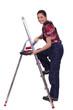 craftswoman painter climbing a ladder