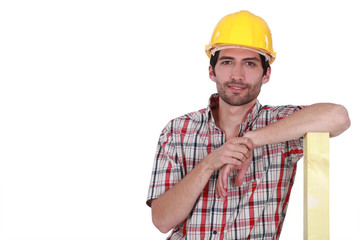 Confident carpenter on white background
