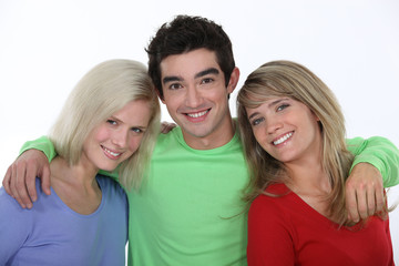 Smiling man with two young women
