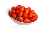 Red tomatoes in a white bowl.