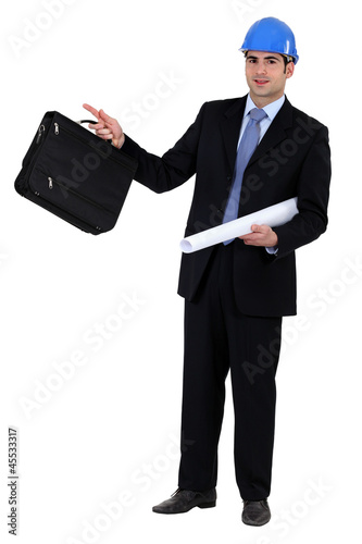 construction businessman holding a blueprint and a briefcase