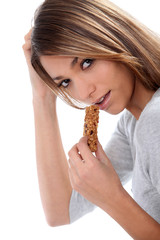 attractive woman eating an almond bar
