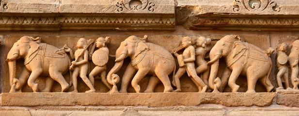 Stone carving bas relief panorama, Lakshmana Temple, Khajuraho,
