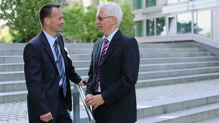 Two businessmen talking outside