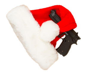 Weapon (firearm) concealed in santas hat