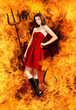 Sexy young brunette woman as devil in fire