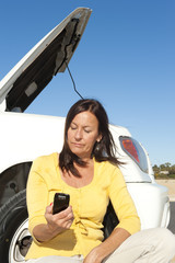 Woman calling road assistance
