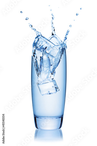 Ice cube splashing into a glass of water.