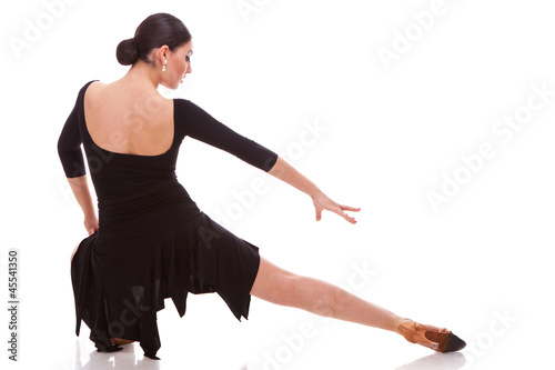 beautiful salsa dancer posing in a lunge