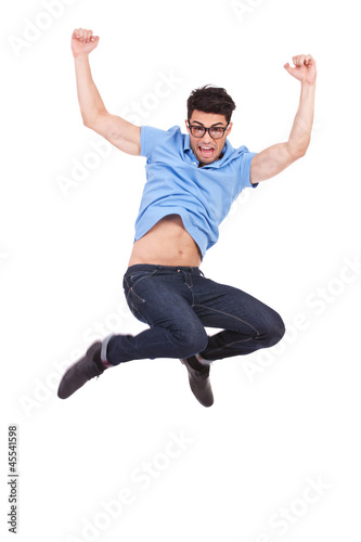 young casual man jumping and shouting