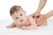 baby getting massage studio shot on white background