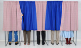 People in Voting Booths