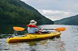 Fototapety Woman Kayaking on Mountain Lake